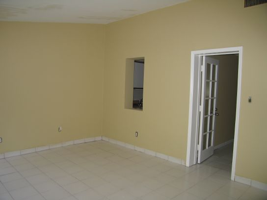 1590n-back-living-area-looking-to-kitchen-and-front-of-residence